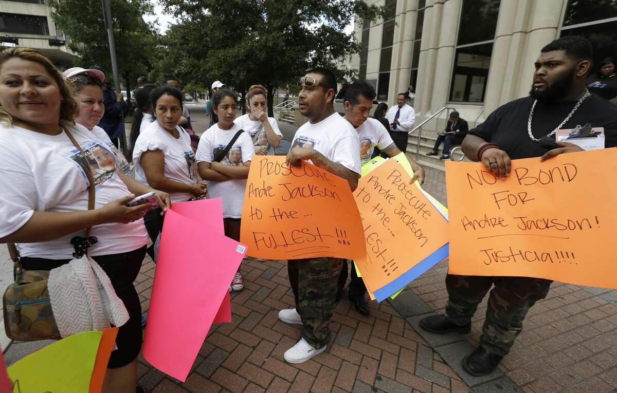 Supporters of the family of Josue Flores gather to protest outside Criminal Courthouse, 1201 Franklin, Monday, June 6, 2016 after the court appearance of Andre Timothy Jackson, who is accused of stabbing death of 11-year-old Josue Flores. ( Melissa Phillip/ Houston Chronicle)
