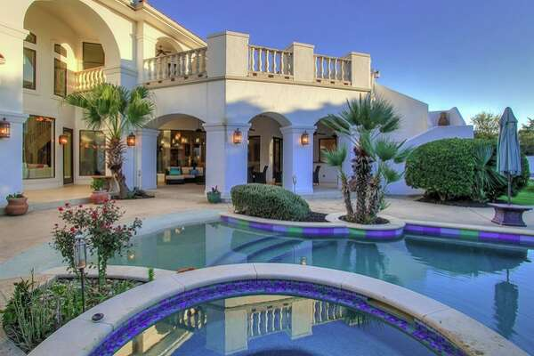 This home at 531 Berwick Town in Shavano Park boasts five bedrooms, five full bathrooms, a pool and lush landscaping.
