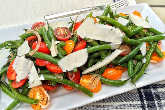 Warm green bean salad with tomatoes and shaved ricotta salata