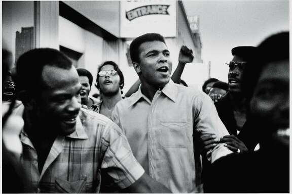 "Muhammad Ali walks through the streets of New York City with members of the Black Panther Party in September 1970. As seen in the documentary ""the Trials of Muhammad Ali."" American heavyweight boxing champion Muhammad Ali walks through the streets with members of the Black Panther Party, New York, New York, September 1970. Ali was sentenced to five years in prison and his championship title revoked after he was convicted of draft evasion upon his refusal to serve with the American army in Vietnam upon grounds of conscientious objection. The decision was overtuned in 1971 but Ali became a figurehead of resistance and a hero of the people."