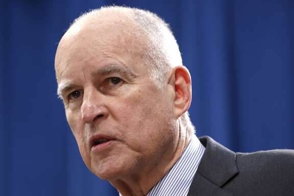 California Gov. Jerry Brown answers a reporter's question concerning his revised 2016-17 state budget plan released Friday, May 13, 2016, in Sacramento, Calif. Brown proposed a $122.2 billion spending plan for California, down slightly from his January proposal as tax revenues are expected to fall below expectations. (AP Photo/Rich Pedroncelli)