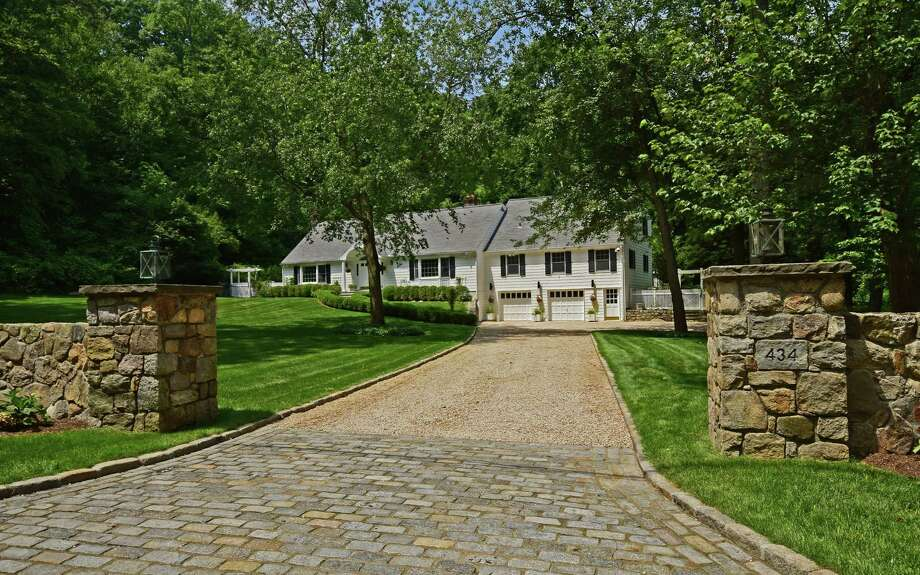 Tucked at the end of one of the longest cul-de-sacs in New Canaan, this meticulously maintained and expanded 10-room charmer sits on a pristine 1.46 acres of property on the west side of town. Photo: Contributed Photos