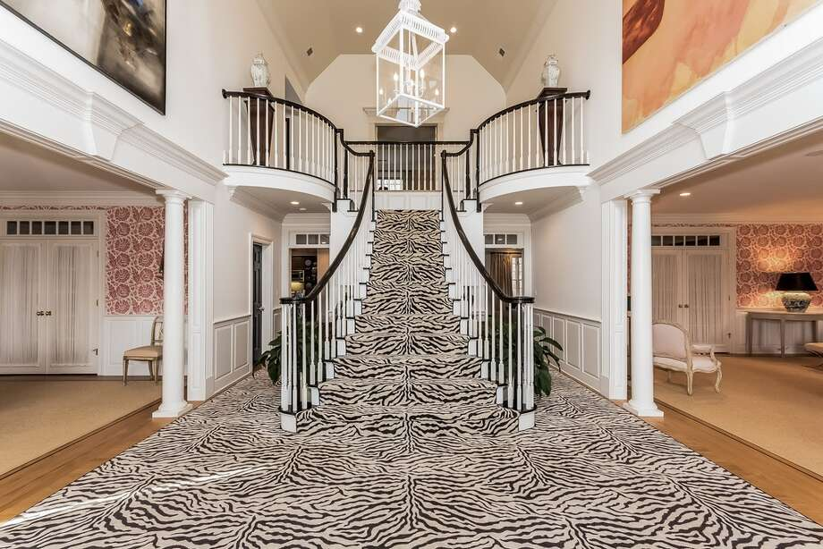 70 Burrwood Cmn, Fairfield, CT 06824 6 beds 8 baths 7,365 sqft Features: Game room, media space, office, gourmet kitchen with wet bar, cappuccino bar View full listing on Zillow Photo: Zillow