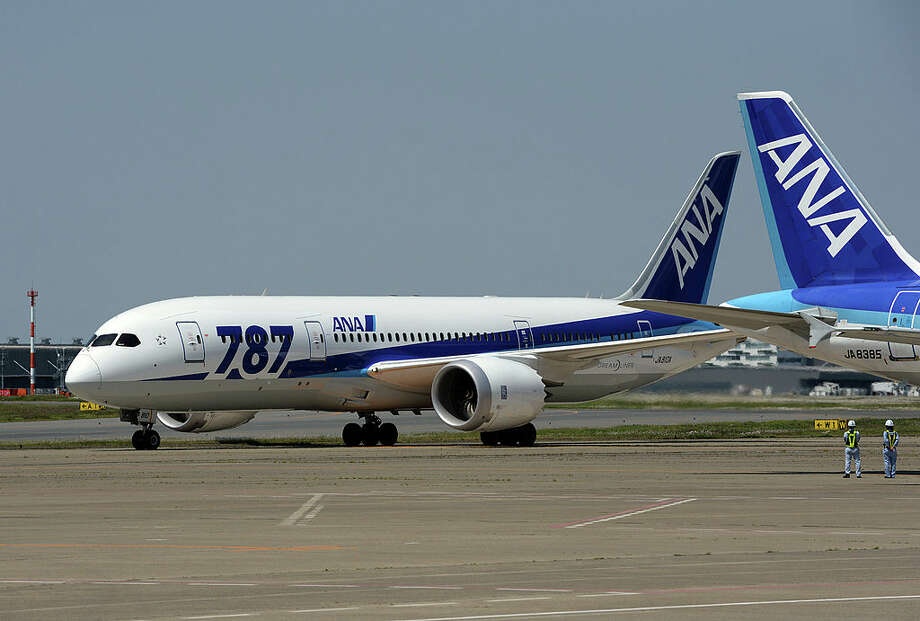 An All Nippon Airways (ANA) Boeing 787 taxies on the runway after its test flight at the Haneda International airport in Tokyo on April 28, 2013.  A Dreamliner test flight with top Boeing and All Nippon Airways' executives aboard took off from a Tokyo airport, three months after the worldwide fleet of 787s was grounded.  AFP PHOTO / TOSHIFUMI KITAMURA        (Photo credit should read TOSHIFUMI KITAMURA/AFP/Getty Images) Photo: AFP/Getty Images