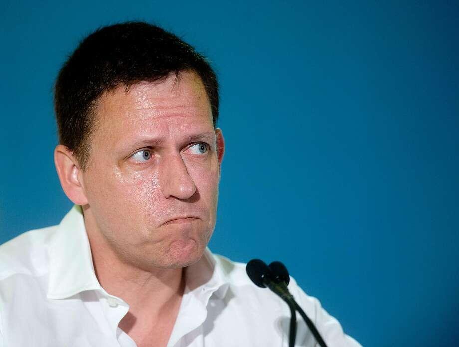 Peter Thiel, head of Clarium Capital Management LLC and founding investor in PayPal and Facebook, listens during the LendIt USA 2016 conference in San Francisco in April. Photo: Noah Berger, Bloomberg