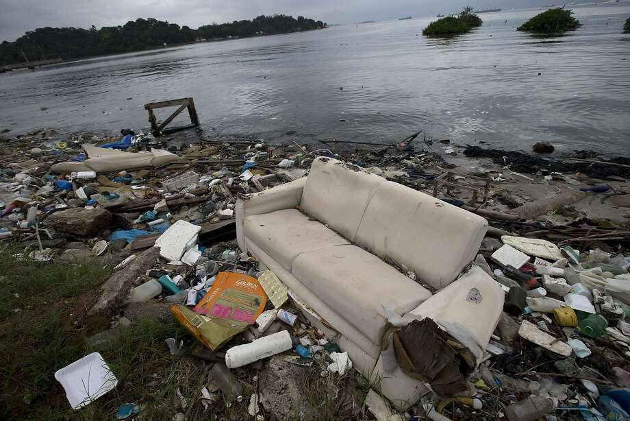 In this June 1, 2015 file photo, a discarded sofa litters the shore of Guanabara Bay in Rio de Janeiro, Brazil.  Photo: Silvia Izquierdo, Associated Press