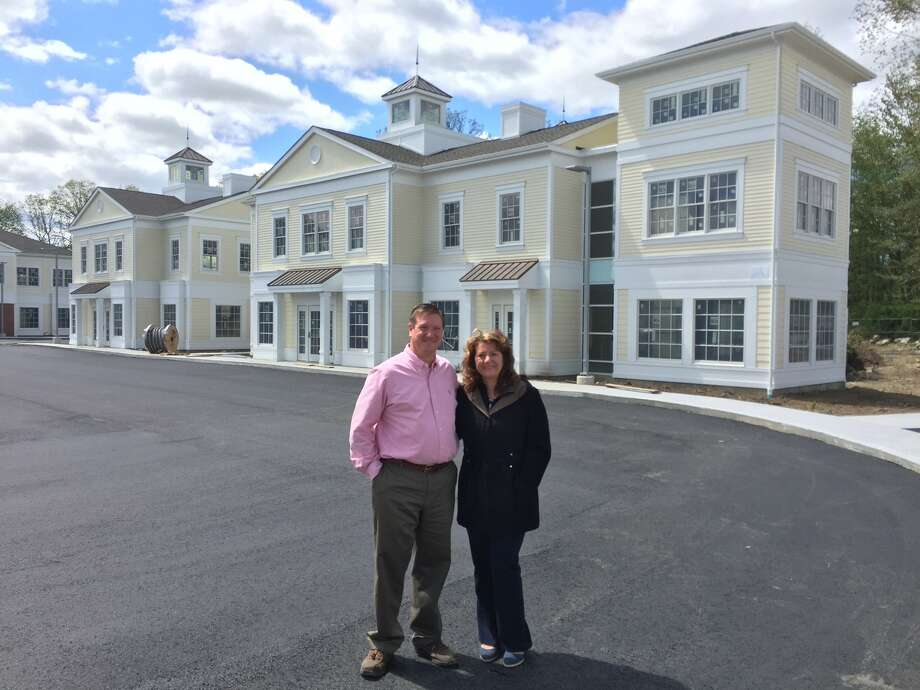 Standing in front of the Village at Lexington Gardens are Doug Rose, vice president of asset services for Coldwell Banker Commercial Scalzo Group and Betsy Paynter, economic development cooordinator for Newtown. Photo: /