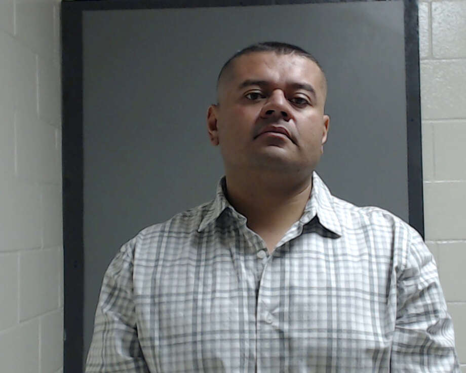 Juan Cerrillo was arrested Saturday and charged with cruelty to a non-livestock animal after he left his police-assigned canine partner in a car and it died. Photo: Texas Department Of Public Safety