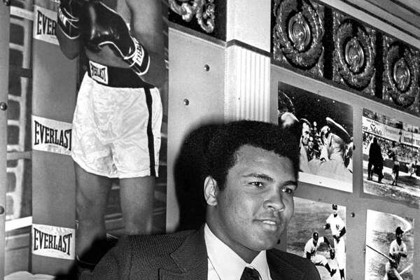 Muhammad Ali shows off the Hickok Belt, a professional athlete of the year trophy awarded annually, in 1975. Ali gave hope to the hopeless, replacing despair with dreams.