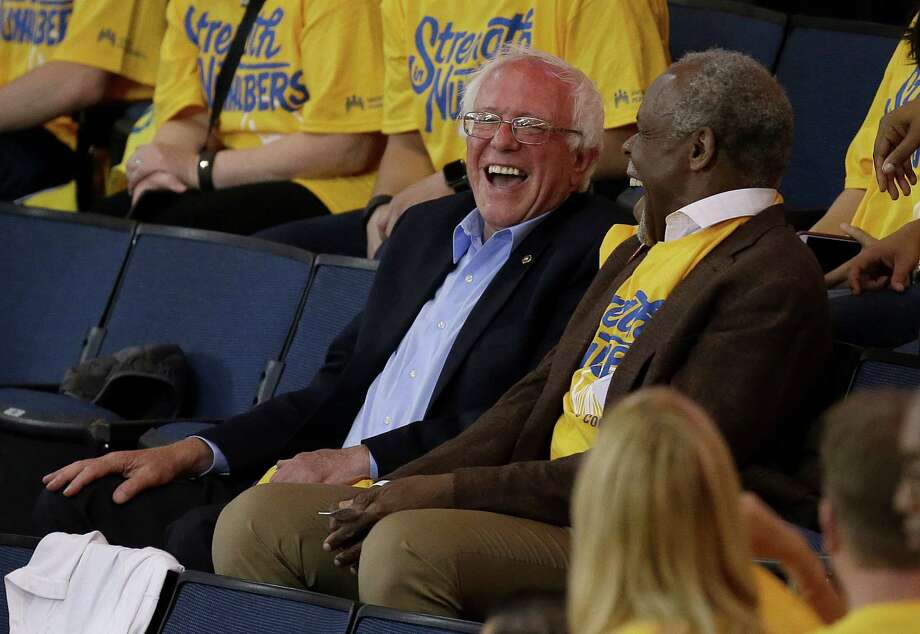 In this file photo, Democratic presidential candidate Sen. Bernie Sanders, I-Vt., left, laughs with actor Danny Glover during Game 7 of the NBA basketball Western Conference finals. Sanders has been on a roll and could win California. Photo: Ben Margot /Associated Press / AP