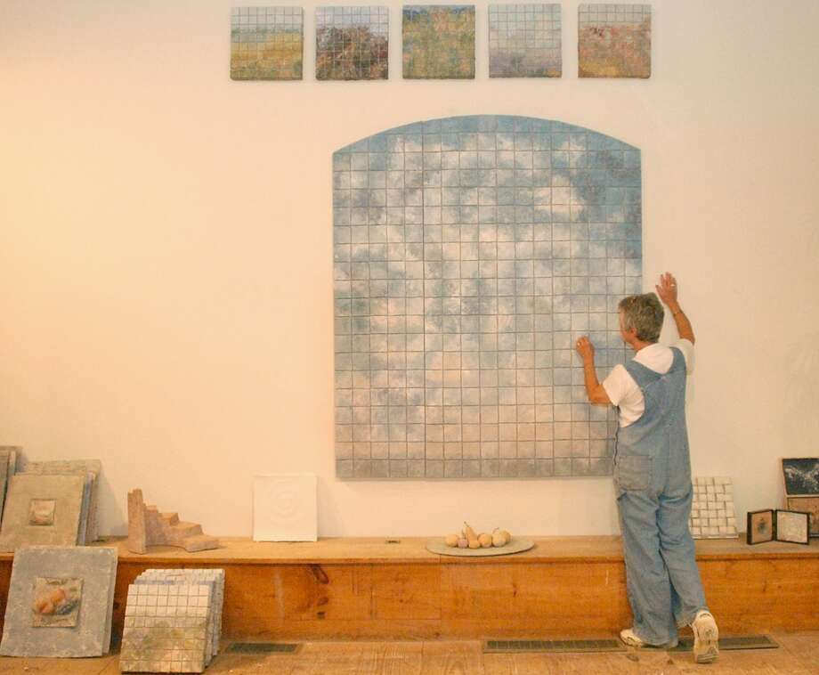 Elizabeth MacDonald in her studio looking over one of her pieces of artwork. Photo: File Photo\Wendy Carlson / File Photo / The News-Times File Photo