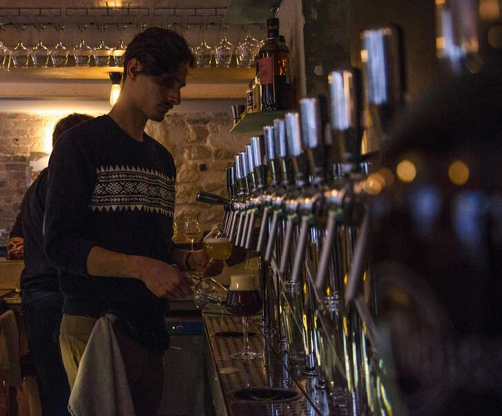 A bartender works the taps at La Fine Mousse, a bar in Paris that focuses firmly on craft brews.