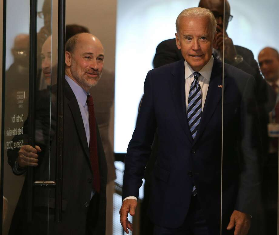 Vice President Joe Biden, right, arrives for a tour of the University of Chicago's National Cancer Institute, Genomic Data Commons at the Shoreland in Chicago, Monday, June 6, 2016. At left holding door is Robert Grossman, director of the GDC project and professor of medicine at U of Chicago. Biden is unveiling a public database for clinical data on cancer on Monday that aims to help researchers and doctors better tailor new treatments to individuals. (Antonio Perez/ Chicago Tribune via AP) Photo: Antonio Perez, Associated Press