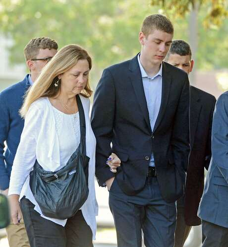 In this June 2, 2016 photo, Brock Turner, 20, right, makes his way into the Santa Clara Superior Courthouse in Palo Alto, Calif. The six-month jail term given to Turner, the former Stanford University swimmer who sexually assaulted an unconscious woman after both attended a fraternity party, is being decried as a token punishment. (Dan Honda/Bay Area News Group via AP) MAGS OUT NO SALES Photo: Dan Honda, Associated Press