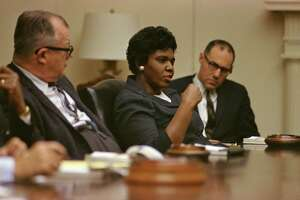 Texas State Senator Barbara Jordan, center, meeting with Andy Biemillier (Legislative Director, AFL-CIO), and John Doar (Civil Rights Division, Dept. of Justice) in the White House.