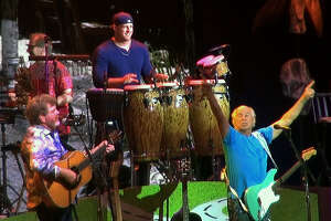 J.J. Watt plays conga drums for Jimmy Buffett at The Woodlands Pavilion.