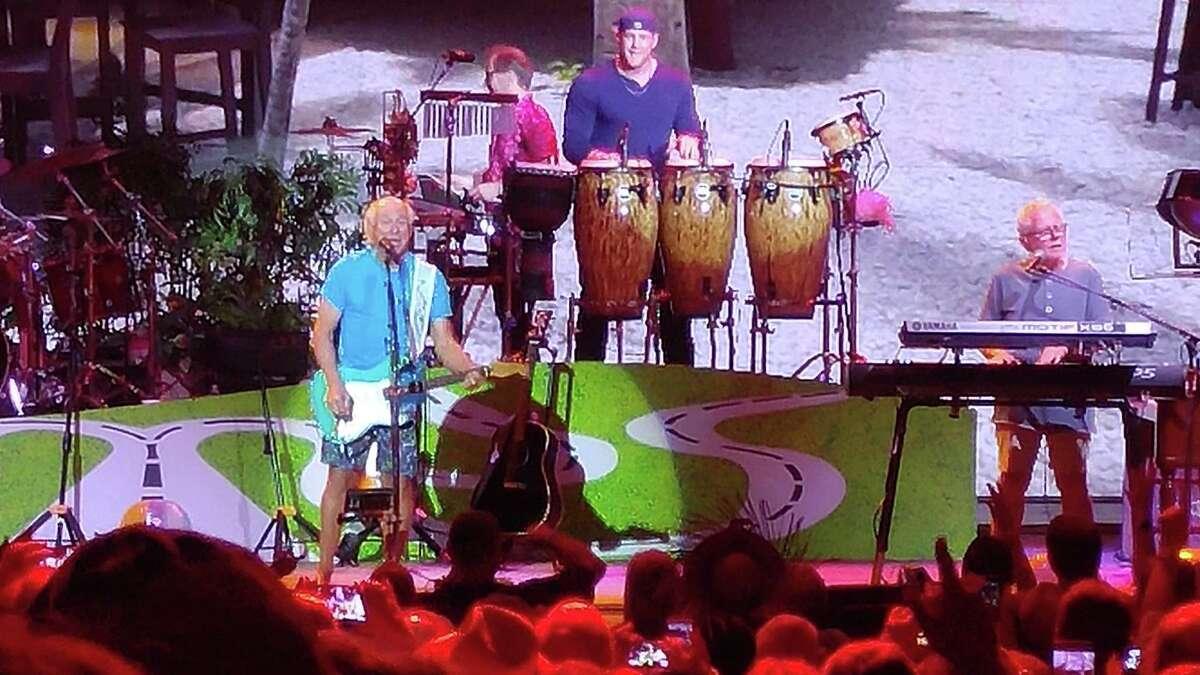 JJ Watt plays bongos at the Jimmy Buffett concert at the Woodlands Pavilion