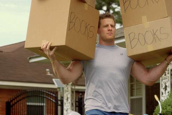 "Houston Texans defensive end J.J. Watt is shown carrying boxes during a commercial for Reliant's ""first-month free"" campaign. In the commercial, he effortlessly carries a sofa by himself and lugs boxes full of books to his one-man moving van. Reliant does offer moving tips, check them out at www.reliant.com, click on ""moving tips."""