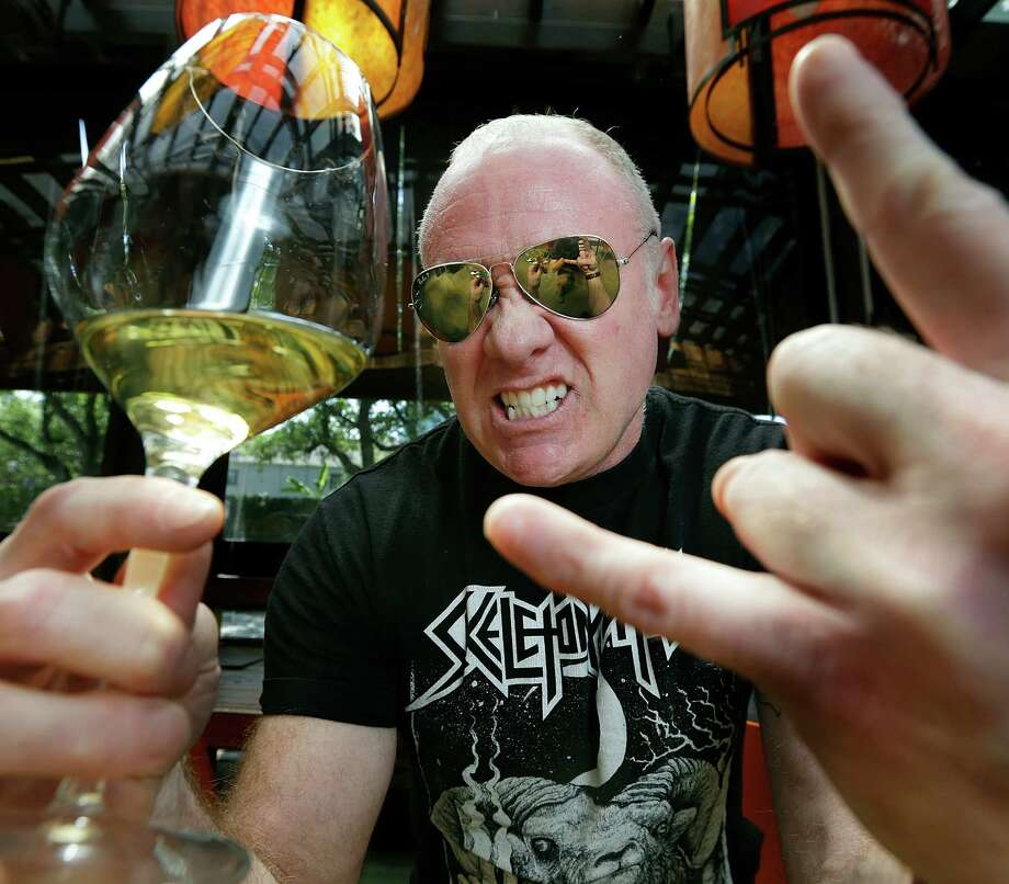 Dale Ellington, wine buyer at Kata Robata, with a 2012 Nova Domus from Terlano winery,Thursday, May 5, 2016, in Houston. Ellington has many facets to his personality, including his love of metal music, which he is not afraid to express. ( Mark Mulligan / Houston Chronicle ) Photo: Mark Mulligan, Staff / © 2016 Houston Chronicle