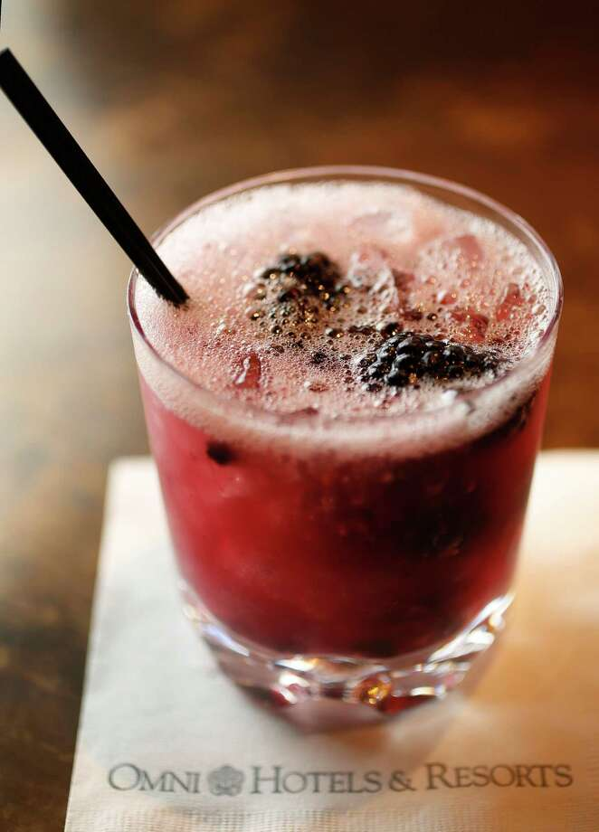 The Black Swan Cocktail-featuring Tito's Vodka, Chandon Sparkling, and lemon juice with blackberries at Black Swan in the Omni Houston Hotel, Wednesday, May 18, 2016. The Black Swan recently underwent a $2 million renovation, and is the only hotel nightclub in Houston. ( Karen Warren  / Houston Chronicle ) Photo: Karen Warren, Staff / © 2016 Houston Chronicle