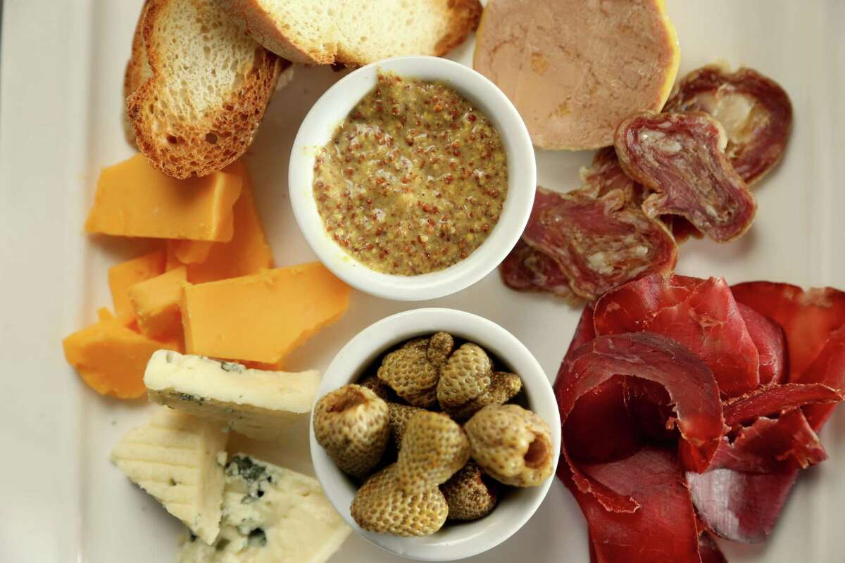 Harold's Tap Room's charcuterie and cheese spread consists of Houston Dairymaids cheeses, cured meats, foie gras, pickled vegetables, mustard and bread.