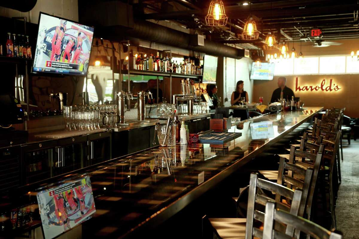 Customers can grab a drink at Harold's Tap Room before dining upstairs.
