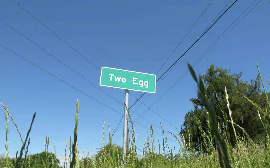 A sign welcomes motorists to Two Egg, Florida. Located about 70 miles from Tallahassee, Florida, Two Egg is a farming town where eggs used to be traded for goods. Photo: Brendan Farrington, STF / Copyright 2016 The Associated Press. All rights reserved. This material may not be published, broadcast, rewritten or redistribu