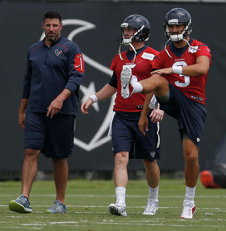 Quarterback Tom Savage, right, has impressed the Texans with his work ethic, including preparing as if he was going to play last season when being on injured reserve meant that was an impossibility. Photo: Karen Warren, Staff / © 2016 Houston Chronicle