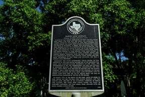 A historical marker outside musician Janis Joplin's childhood home on 32nd Street in Port Arthur offers a brief biography of Joplin's life. Joplin graduated from Thomas Jefferson High School in 1960.  Photo taken Monday 6/6/16 Ryan Pelham/The Enterprise