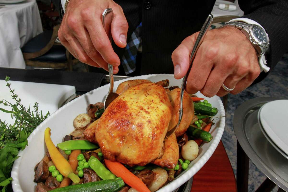 The heritage free-range chicken for two, carved tableside, is an old-school joy at La Table.