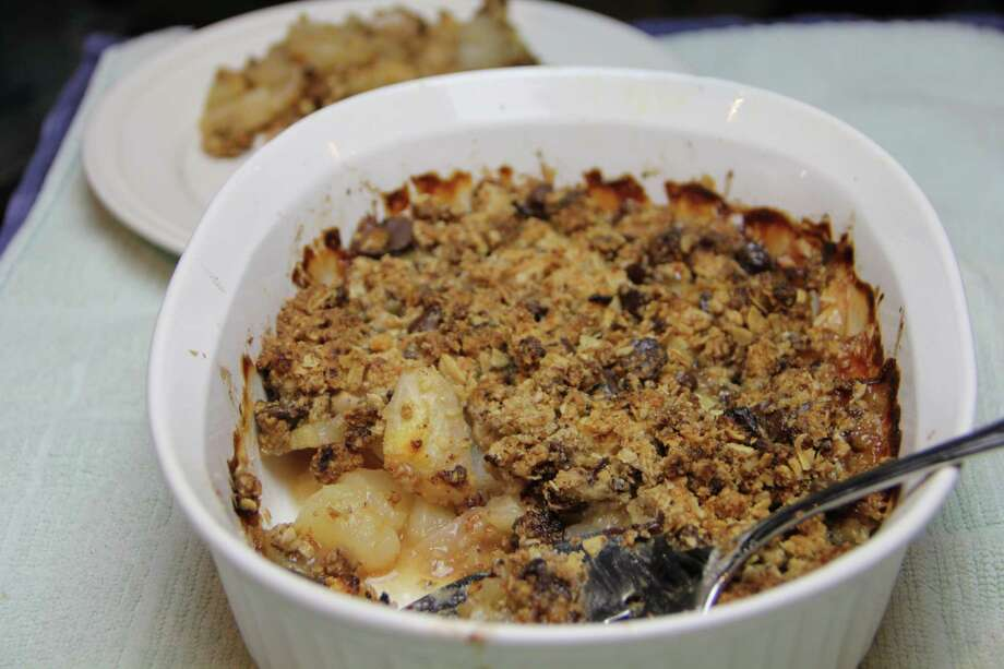 Making desserts at home eliminates preservatives, other chemicals and lots of sugar. Pear and Dark Chocolate Crumble turns almond flour and oats into a tasty topping that skips the empty calories. Photo: Melissa D'Arabian, STF / AP