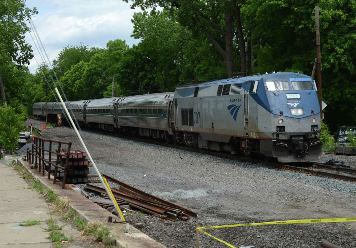 An Amtrak passenger train from Schenectady heads down the line near Broadway and North Pearl Street where work has begun on adding a second track on Monday, June 6, 2016, in Albany, N.Y. The second track between Albany and Schenectady will remove a bottleneck on AmtrakOs Empire Corridor connecting New York City and Buffalo. (Will Waldron/Times Union)