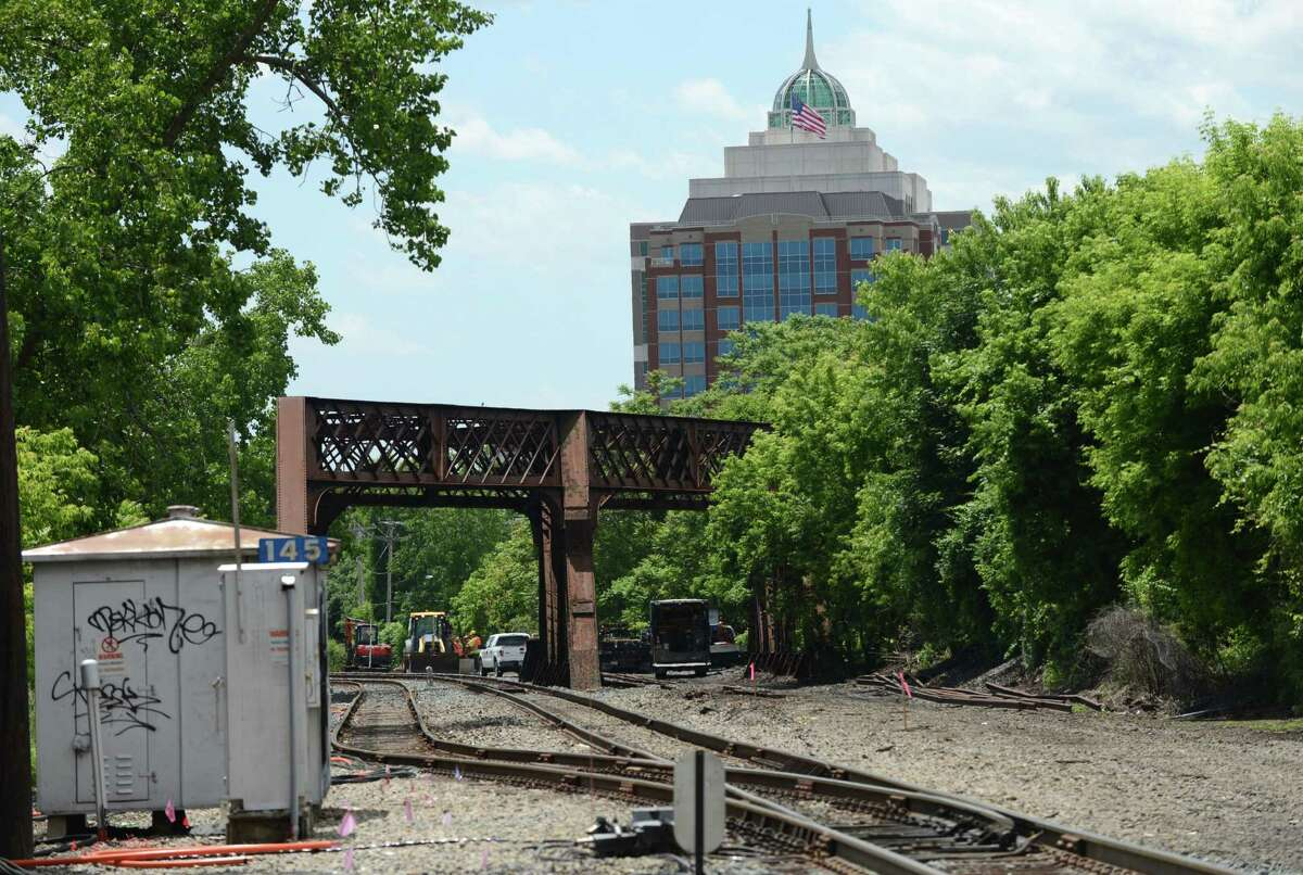 The State Department of Environmental Conservation Headquarters building is visible near train tracks at Broadway where work has begun on a second track on Monday, June 6, 2016, in Albany, N.Y. The second track between Albany and Schenectady will remove a bottleneck on Amtrak?'s Empire Corridor connecting New York City and Buffalo. (Will Waldron/Times Union)