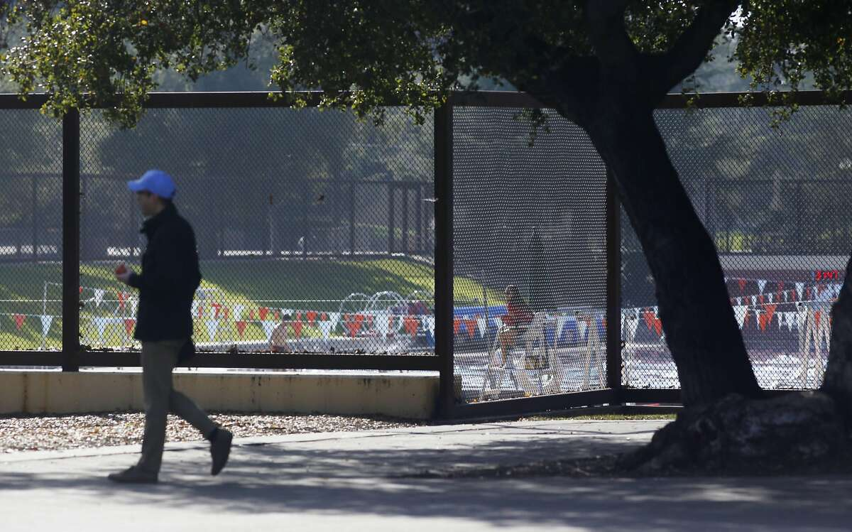 After a Stanford University Swimmer is accused of rape, a person walks past the Avery Aquatic Center on January 28, 2015 in Palo Alto, Calif.