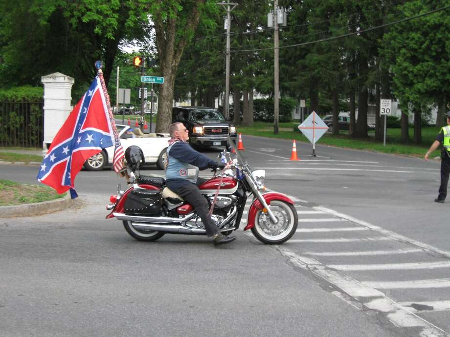 Unidentified man displaying Confederate flag on motorcycle during Memorial Day parade in Saratoga Springs on Thursday, May 26, 2016. (Courtesy Kyle Hughes, NYSNYS.com)