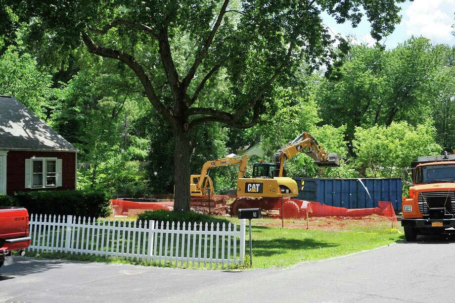A home located at 7 Ayre Street that was destroyed by fire in the winter was knocked down on Monday, June 6, 2016, in Guilderland, N.Y.   (Paul Buckowski / Times Union) Photo: PAUL BUCKOWSKI / 40036858A