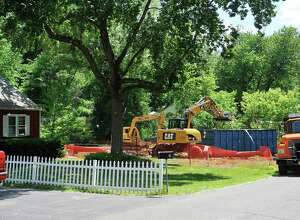 A home located at 7 Ayre Street that was destroyed by fire in the winter was knocked down on Monday, June 6, 2016, in Guilderland, N.Y.   (Paul Buckowski / Times Union)