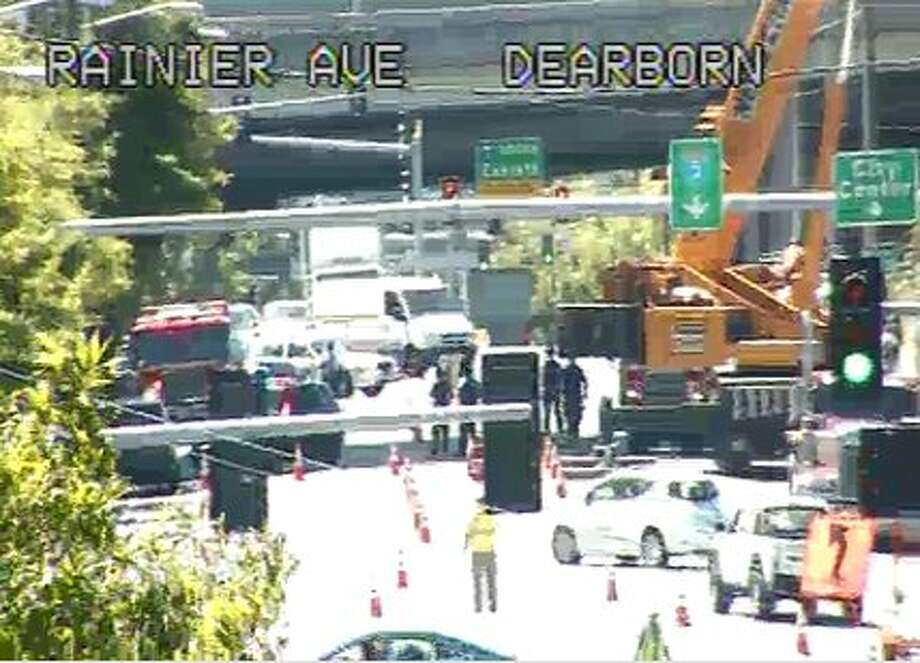"""South Dearborn Street was shut down near 12th Avenue South Monday afternoon while fire crews extinguished a series of small trash fires set in the homeless encampment known as """"The Jungle."""" Photo: WSDOT"""