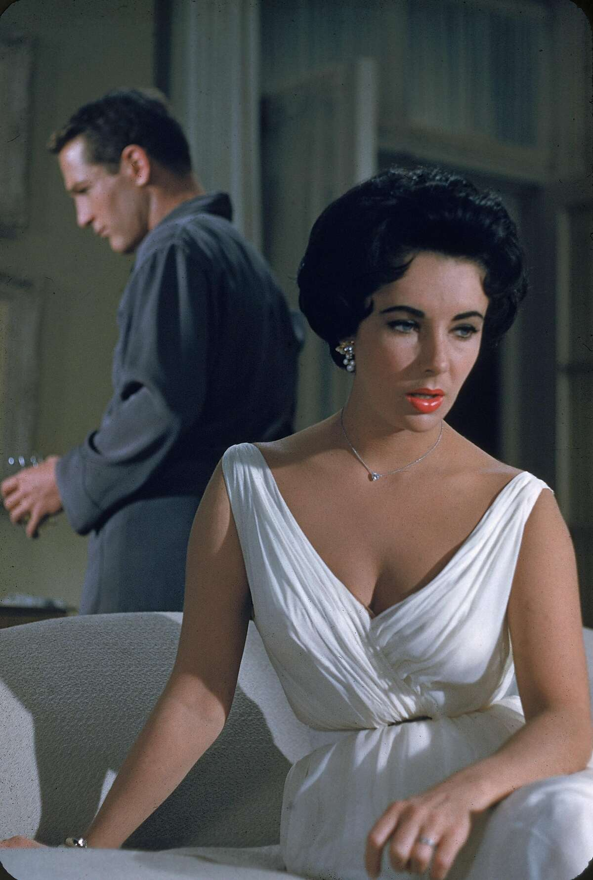 American actor Paul Newman and British-born actor Elizabeth Taylor have a conversation in a still from the film, 'Cat On A Hot Tin Roof', directed by Richard Brooks, 1958. (Photo by MGM Studios/Courtesy of Getty Images)