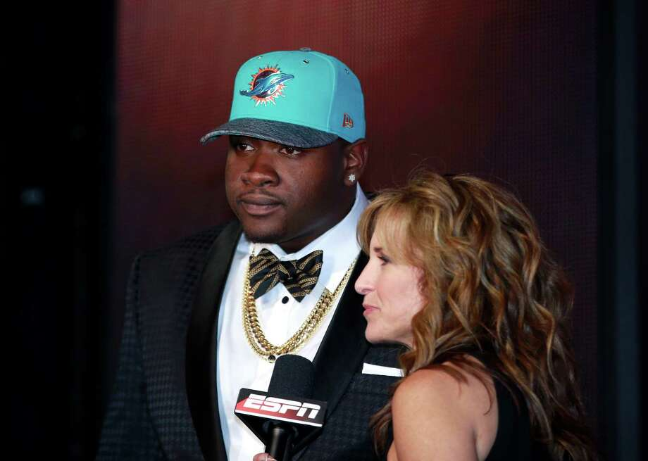 Mississippi's Laremy Tunsil is interviewed by ESPN reporter Suzy Kolber after being selected by the Miami Dolphins as the 13th pick in the first round of the 2016 NFL draft on April 28, 2016, in Chicago. Photo: Jeff Haynes /Associated Press / FR171008 AP