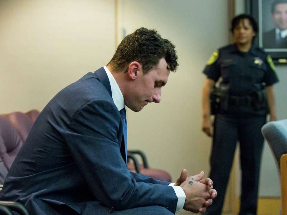 Former Texas A&M and Cleveland Browns quarterback Johnny Manziel sits at the back of the courtroom while his defense attorneys confer with the prosecution after he appeared before Judge Roberto Canas at the Frank Crowley Courts Building on May 5, 2016, in Dallas. Photo: Smiley N. Pool /Dallas Morning News / The Dallas Morning News