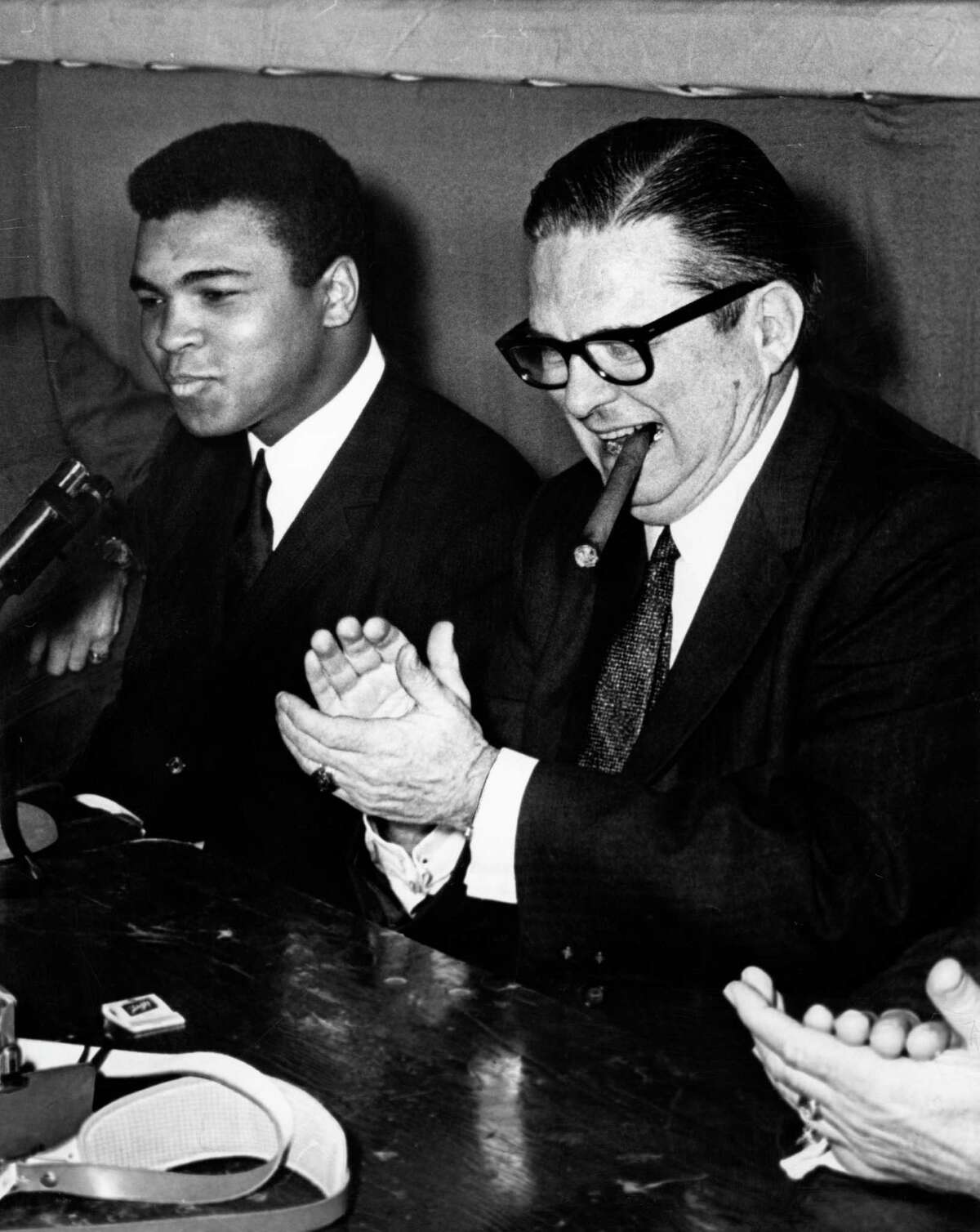 Muhammad Ali and Roy Hofheinz share a laugh at a press conference on Jan. 10, 1967, after Ali arrived in Houston to train for his fight against Ernie Terrell in the Astrodome.