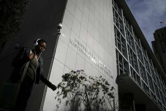 Jordan Bosse, of San Francisco, walks past  UC Hastings main building at 198 McAllister Street on Tuesday Feb. 10, 2015 in San Francisco, Calif,  There is a three part proposal to improve the campus which would include this building a vacant lot at 333 Golden Gate Avenue and 100 McAllister.
