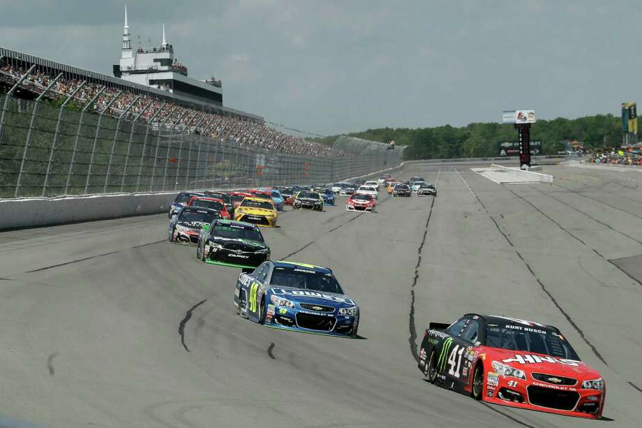 Kurt Busch (41) drives into Turn 1 during the NASCAR Sprint Cup series auto race at Pocono Raceway, Monday, June 6, 2016, in Long Pond, Pa. (AP Photo/Matt Slocum) ORG XMIT: PAMS113 Photo: Matt Slocum / Copyright 2016 The Associated Press. All rights reserved. This m