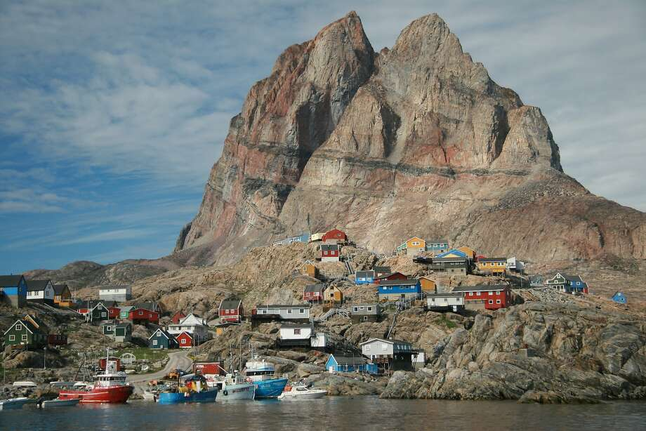 Uummannaq, a settlement 400 miles north of the Arctic Circle in western Greenland, is named for its heart-shaped mountain. Photo: Todd Pitock, Special To The Chronicle