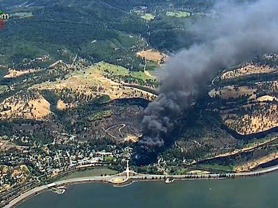 In this frame from video provided by KGW-TV, smoke billows from a Union Pacific train that derailed Friday, June 3, 2016 in Oregon's scenic Columbia River Gorge. The accident sparked a fire and an oil spill near the Columbia River. No injuries were reported. (KGW-TV via AP) / KGW-TV