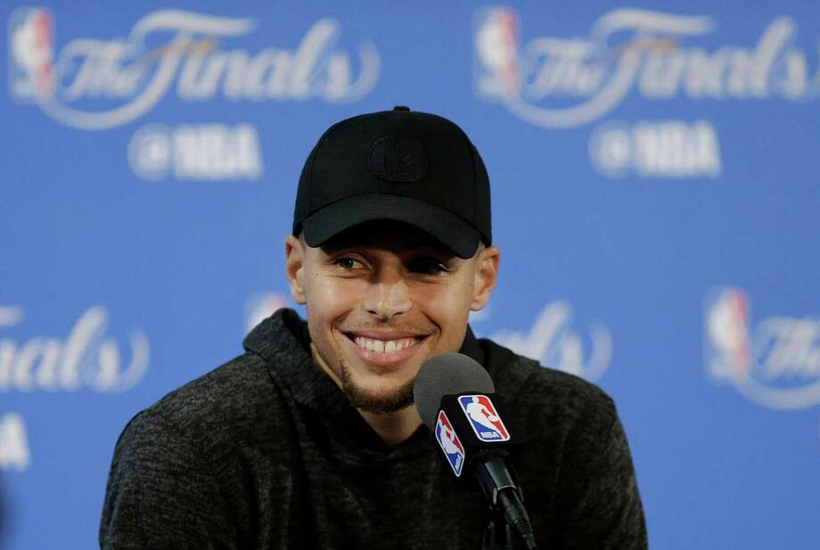 Golden State Warriors guard Stephen Curry smiles at a news conference after Game 2 of basketball's NBA Finals against the Cleveland Cavaliers in Oakland, Calif., Sunday, June 5, 2016. The Warriors won 110-77. (AP Photo/Ben Margot) ORG XMIT: OAS163 Photo: Ben Margot / AP