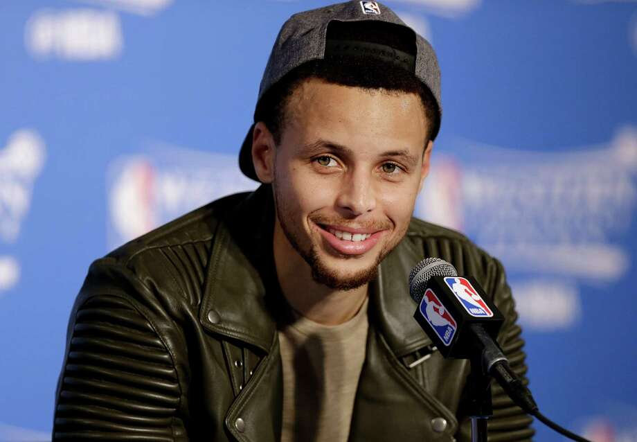 Golden State Warriors guard Stephen Curry smiles during a news conference after Game 7 of the NBA basketball Western Conference finals against the Oklahoma City Thunder in Oakland, Calif., Monday, May 30, 2016. The Warriors won 96-88. (AP Photo/Ben Margot) Photo: Ben Margot, STF / AP