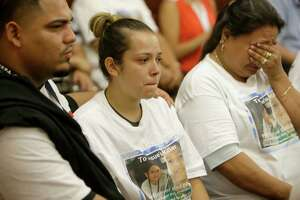 Isidro Barrera, left, comforts his wife, Guadalupe Flores, on Monday as they watch the court appearance of Andre Timothy Jackson. Flores is the sister of slain 11-year-old Josue Flores. Jackson has been charged with murder in Josue's stabbing death.