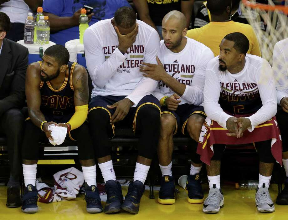 Cleveland Cavaliers' Kyrie Irving, from left, LeBron James, Dahntay Jones and J.R. Smith sit on the bench during the second half of Game 2 of basketball's NBA Finals against the Golden State Warriors in Oakland, Calif., Sunday, June 5, 2016. (AP Photo/Ben Margot) ORG XMIT: OAS152 Photo: Ben Margot / AP